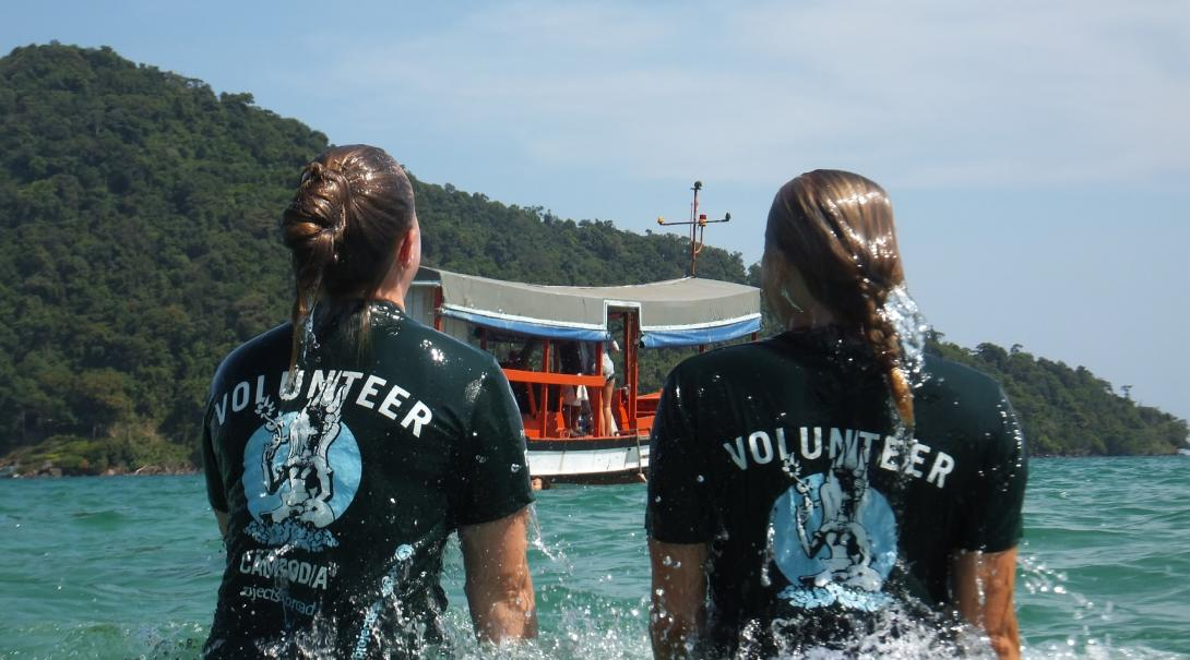 Two Projects Abroad volunteers cool off on a hot day in Cambodia